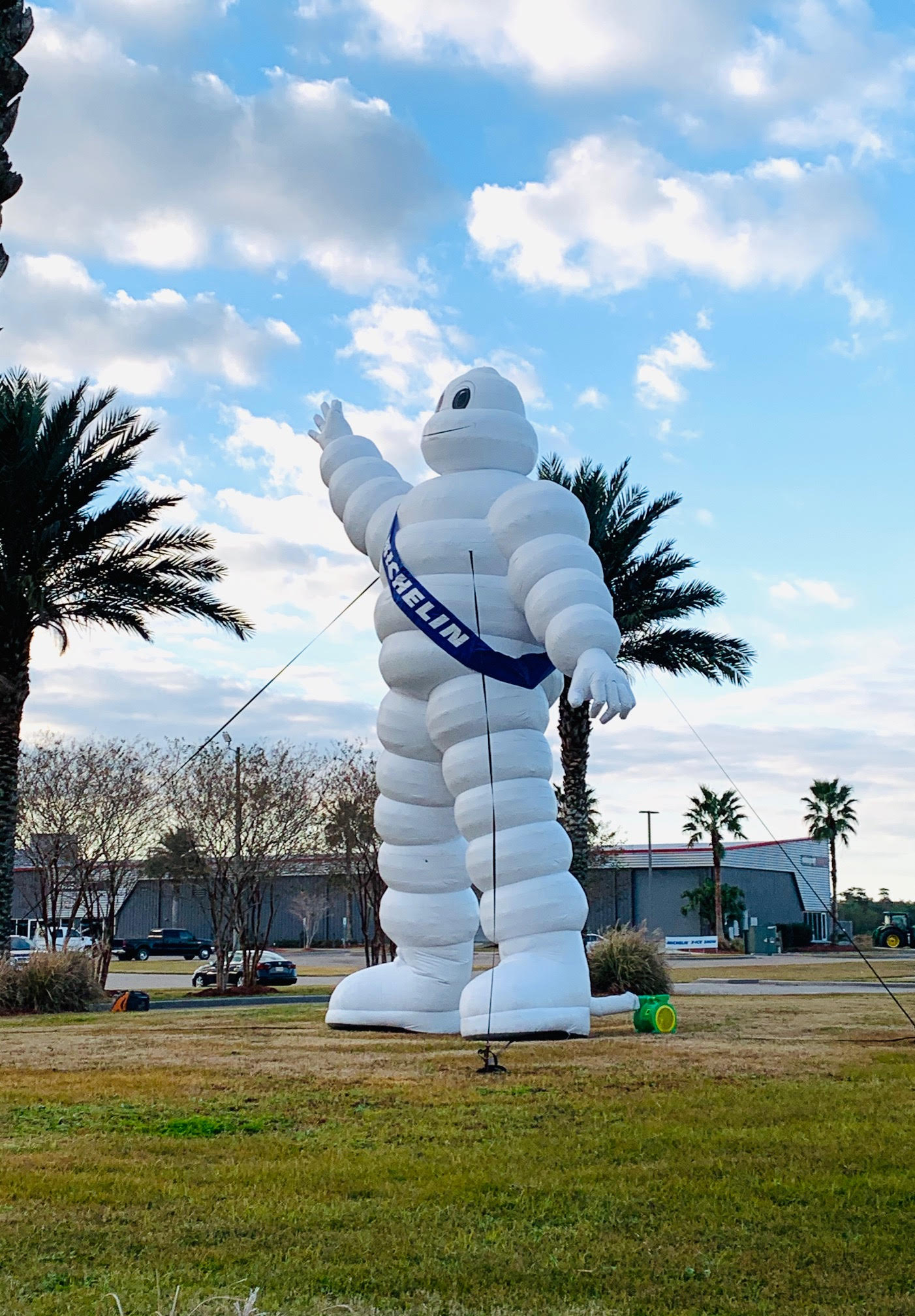 """""""Bib"""" the Michelin man  greets the dealers on their way into the circuit."""